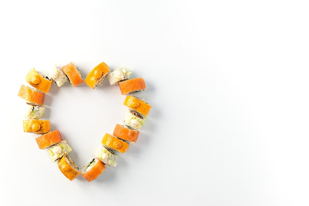 Sushi in the form of a heart on a white background, valentine's day.