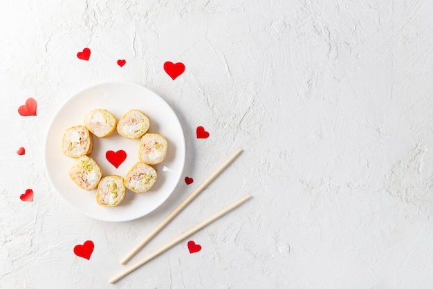 Sushi in the form of a heart on a white plate, valentine's day.