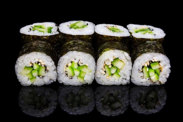 Sushi hosomaki with cucumber and sesame