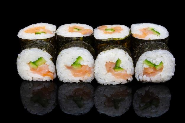 Sushi hosomaki with smoked salmon and cucumbers