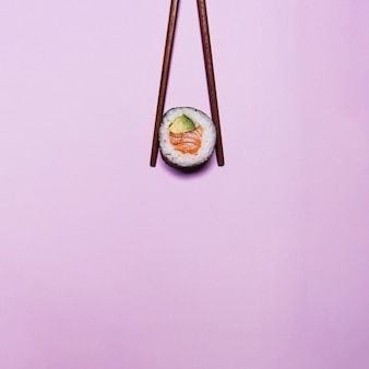 Sushi in chopsticks