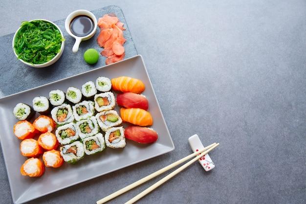 Sushi maki and niguiri soy sauce and wasabi