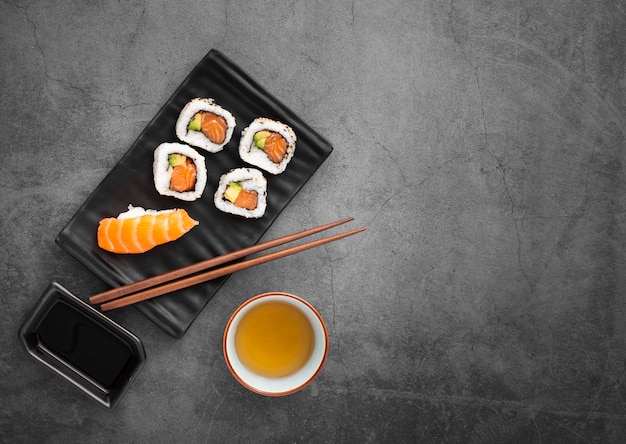 Sushi mix with chopsticks with copy space