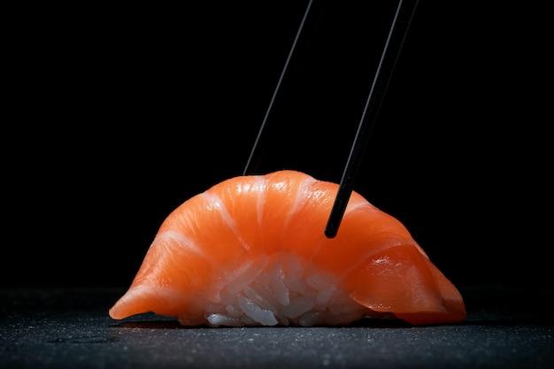 Sushi nigiri with salmon and chopsticks