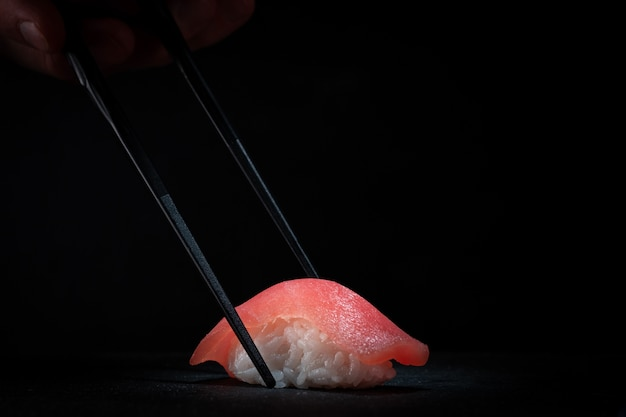 Sushi nigiri with tuna and chopsticks