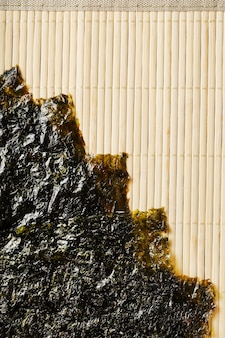 Sushi nori leaves on bamboo surface