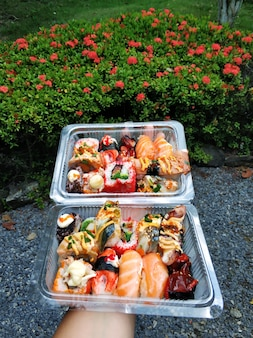 Sushi packed in boxes takeaway food close up