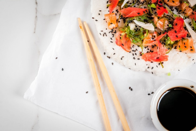 Sushi pizza with salmon, hayashi wakame, daikon, pickled ginger and red caviar