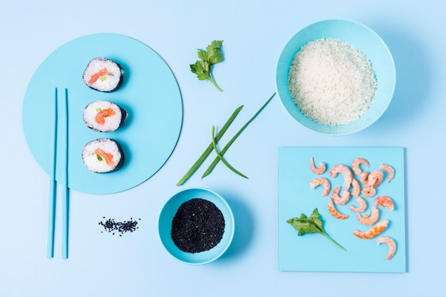 Sushi on plate and bowl with rice