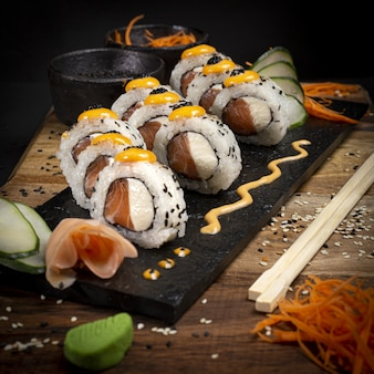 Sushi on a plate dark food photography style