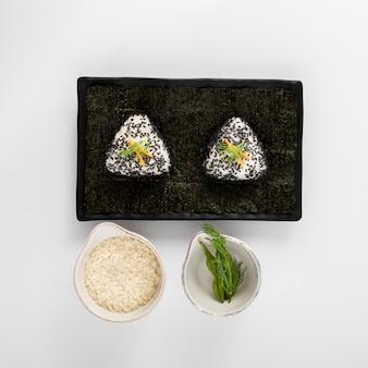 Sushi rice on black slate