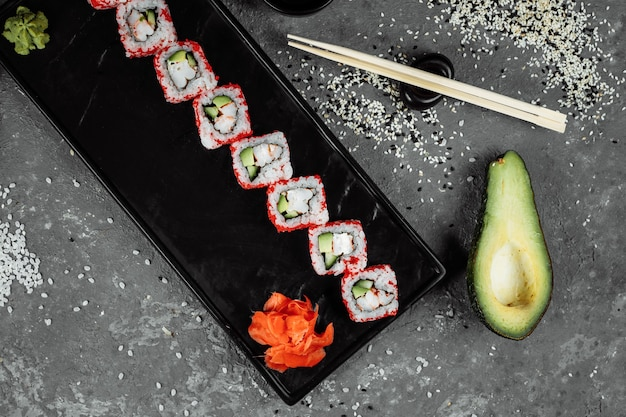 Sushi roll california with shrimp, avocado and cheese. traditional japanese sushi.