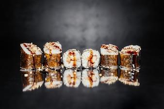 Sushi roll Uguri made of Nori, Pickled rice, eel / perch Unagi, Unagi sauce