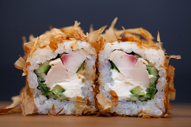 Sushi roll with chicken, cheese and cucumber.