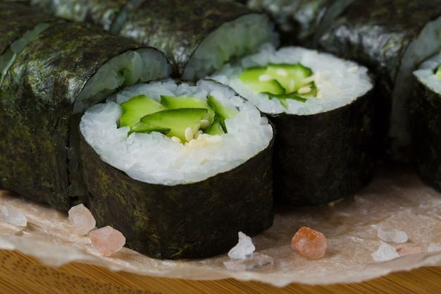 Sushi roll with cucumber and sesame inside. seaweed outside