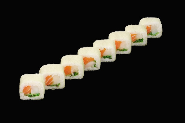 Sushi roll with salmon, scallop, chuka, soy paper, unagi sauce isolated on black