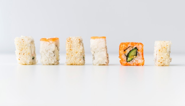 Sushi rolls assortments in row