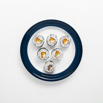 Sushi rolls on blue and white plate