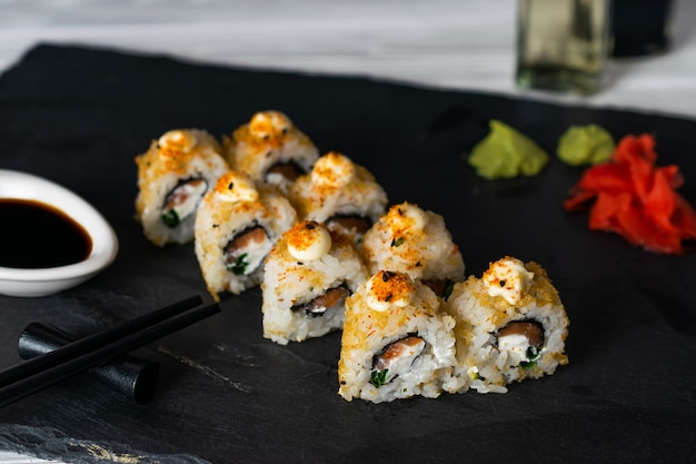 Sushi rolls filled with salmon fish and cream cheese
