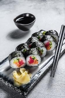 Sushi rolls hosomaki with salmon, avocado and tuna