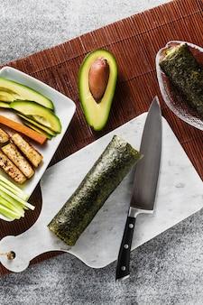 Sushi rolls on a marble cutting board