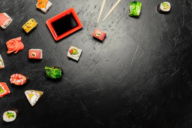 Sushi rolls, nigiri, maki, pickled ginger, wasabi, soy sauce.