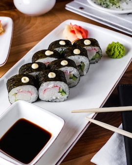 Sushi rolls served with soy sauce, ginger and wasabi