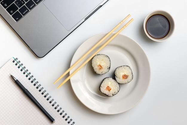 Sushi rolls snacking at work. break time for sushi eating.