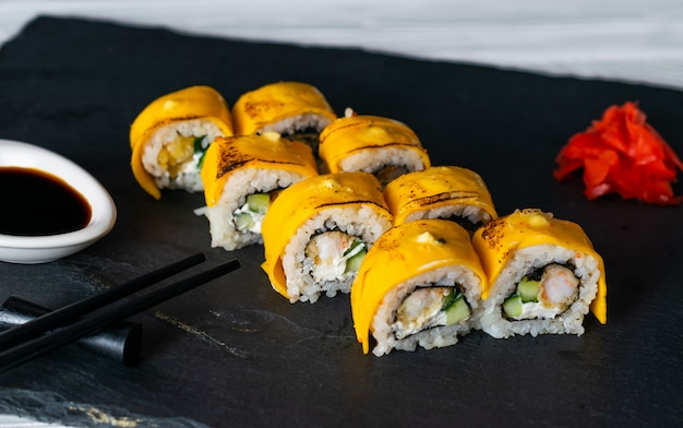 Sushi rolls with japanese omelette and filled with cream cheese and fish