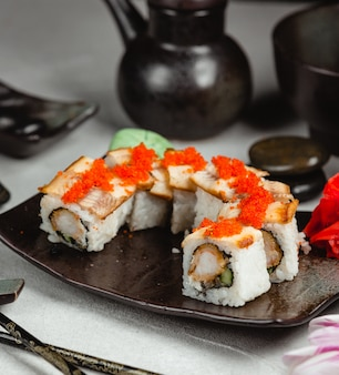 Sushi rolls with red caviar.