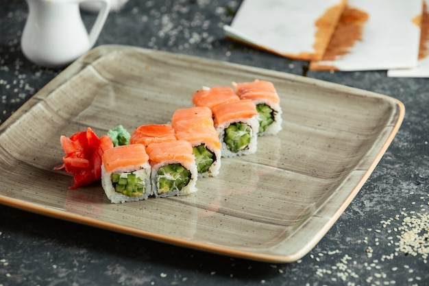 Sushi rolls with salmon and cucumber