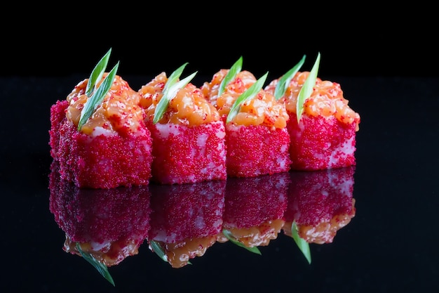 Sushi rolls with salmon, spicy sauce