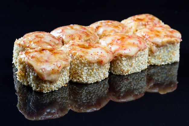 Sushi rolls with squid, mussel and cheese