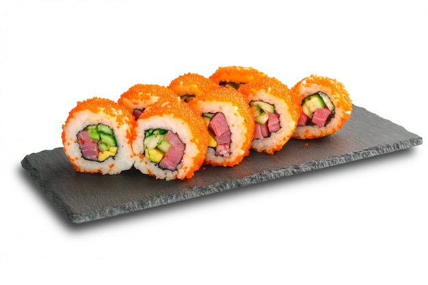 Sushi rolls with tuna, avocado, flying fish caviar and cucumber inside isolated on white .