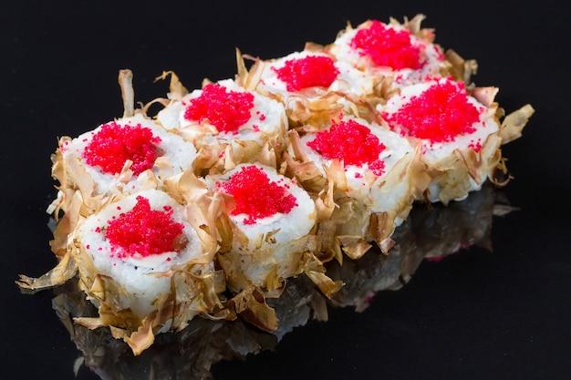 Sushi rolls with tuna or salmon shavings