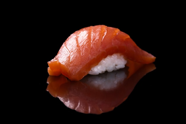 Sushi salmon over black