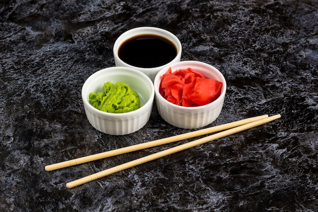 Sushi sauces set with chopsticks