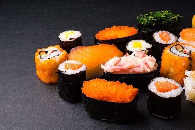 Sushi set on black background, japanese food.
