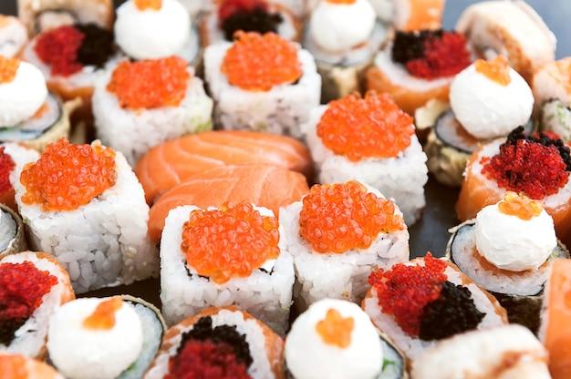 Sushi set on a black surface