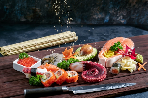 Sushi set. different sashimi, sushi and rolls with octopus