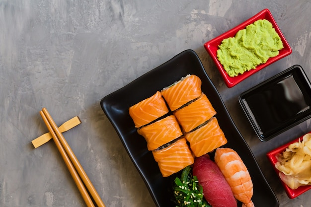 Sushi set on gray concrete