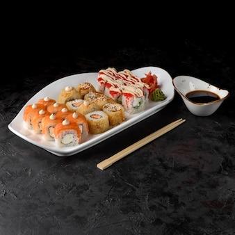 Sushi set okinawa. rolls philadelphia light, rolls tempura with eel, rolls tempura with salmon and california