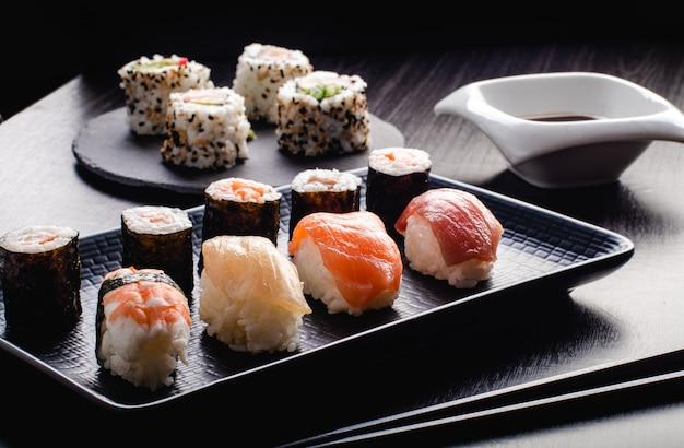 Sushi set sashimi and sushi rolls served