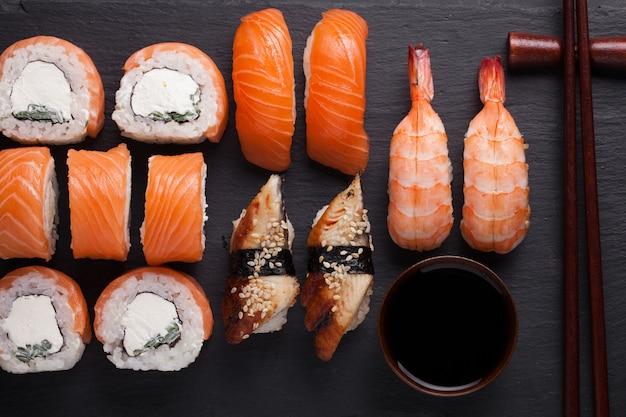 Sushi set sashimi with salmon, shrimp, eel.