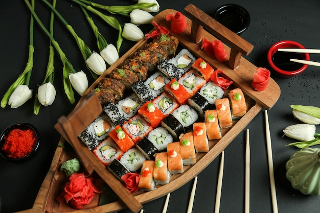 Sushi set with avocado, salmon, crab, sesame seeds, ginger and soy sauce
