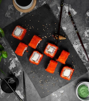 Sushi set with red caviar on the table top view