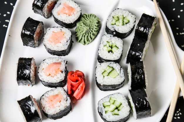 Sushi set with salmon cucumber rice sesame top view