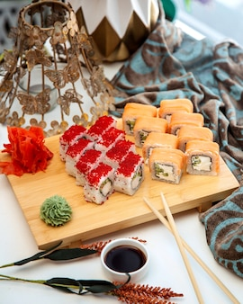 A sushi set with smoked salmon cucumber and japanese mayonnaise