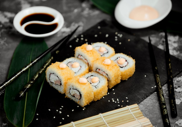Sushi set with yellow caviar fish and rice