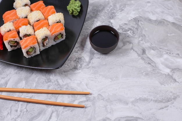 Sushi and sushi roll set on stone table